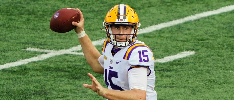 Oct 10, 2020; Columbia, Missouri, USA; LSU Tigers quarterback Myles Brennan (15) throws a pass against the Missouri Tigers during the second half at Faurot Field at Memorial Stadium. Mandatory Credit: Jay Biggerstaff-USA TODAY Sports via Reuters