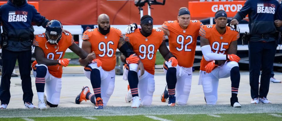 CHICAGO, ILLINOIS - OCTOBER 04: Mario Edwards #97, Akiem Hicks #96, Bilal Nichols #98, Brent Urban #92 and Roy Robertson-Harris #95 of the Chicago Bears take a knee during the national anthem before the game against the Indianapolis Colts at Soldier Field on October 04, 2020 in Chicago, Illinois. (Photo by Quinn Harris/Getty Images)