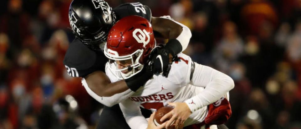 AMES, IA - OCTOBER 3: Linebacker Aric Horne #20 of the Iowa State Cyclones sacks quarterback Spencer Rattler #7 of the Oklahoma Sooners in the second half of the play at Jack Trice Stadium on October 3, 2020 in Ames, Iowa. The Iowa State Cyclones won 37-30 over the Oklahoma Sooners. (Photo by David Purdy/Getty Images)