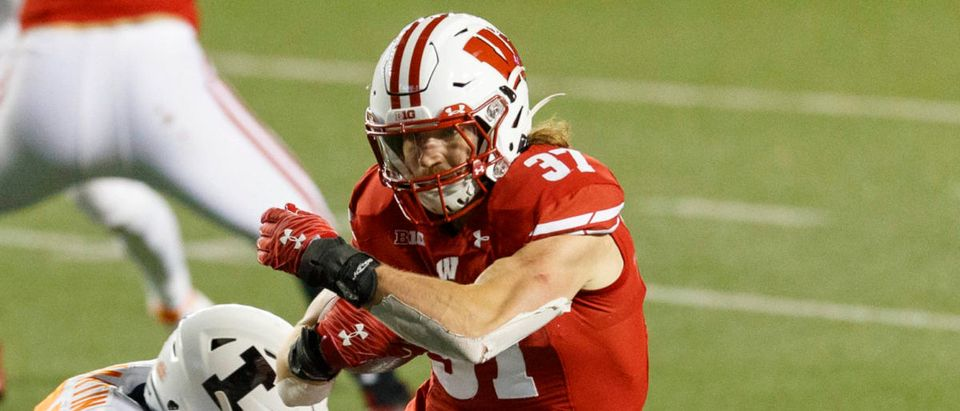 Oct 23, 2020; Madison, Wisconsin, USA; Wisconsin Badgers running back Garrett Groshek (37) rushes with the football during the fourth quarter against the Illinois Fighting Illini at Camp Randall Stadium. Mandatory Credit: Jeff Hanisch-USA TODAY Sports via Reuters
