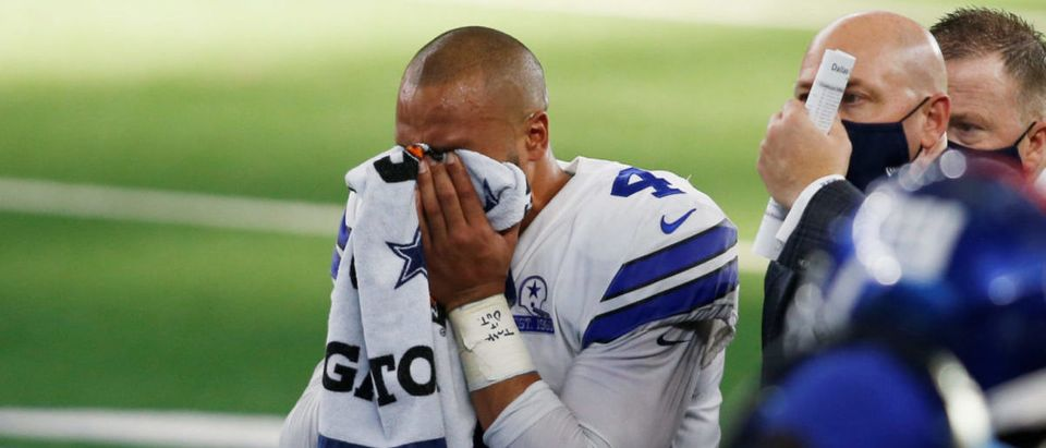 FILE PHOTO: Oct 11, 2020; Arlington, Texas, USA; Dallas Cowboys quarterback Dak Prescott (4) leaves the field with an injury in the third quarter against the New York Giants at AT&T Stadium. Mandatory Credit: Tim Heitman-USA TODAY Sports/File Photo via Reuters