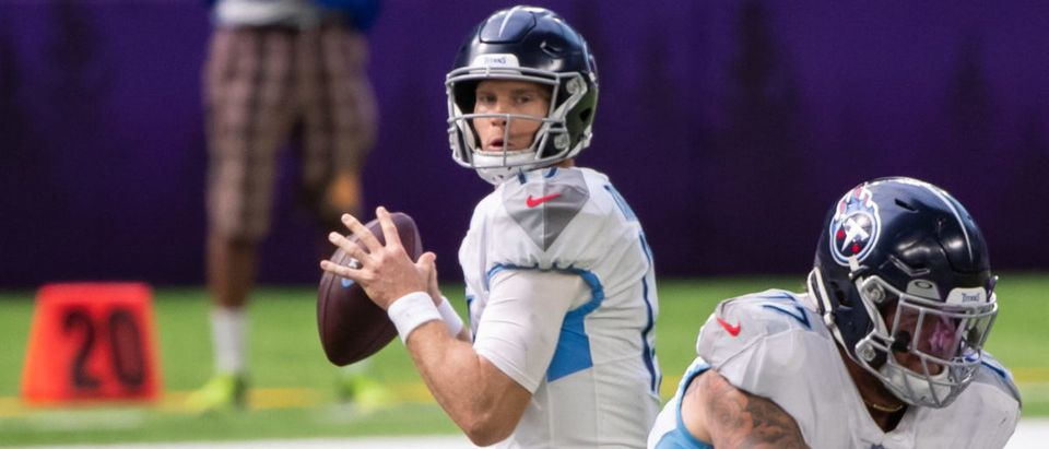 Sep 27, 2020; Minneapolis, Minnesota, USA; Tennessee Titans quarterback Ryan Tannehill (17) drops back to pass in the first quarter against the Minnesota Vikings at U.S. Bank Stadium. Mandatory Credit: Brad Rempel-USA TODAY Sports via Reuters