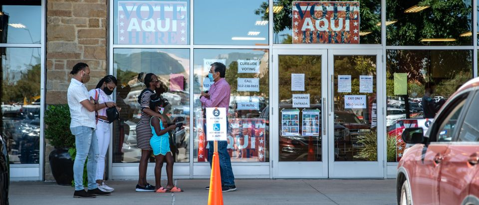 People Go To The Polls On First Day Of Early Voting In Texas
