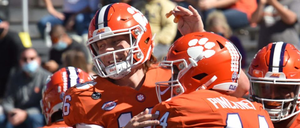 Oct 17, 2020; Atlanta, GA, USA; Clemson Tigers defensive tackle Nyles Pinckney (44) celebrates with Clemson Tigers quarterback Trevor Lawrence (16) after he scored a touchdown during the first half of an NCAA college football game at Bobby Dodd Stadium. Mandatory Credit: Hyosub Shin/Pool Photo-USA TODAY Sports via Reuters
