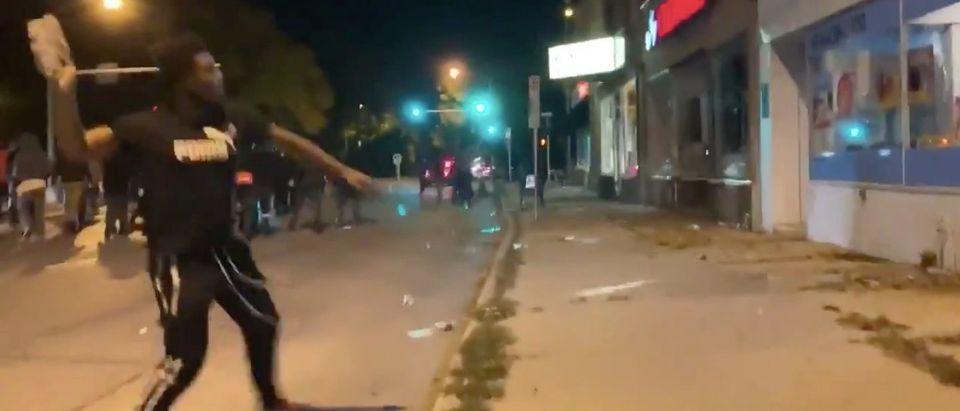 Wisconsin rioter hurls stone into storefront/Twitter via Julio Rosas