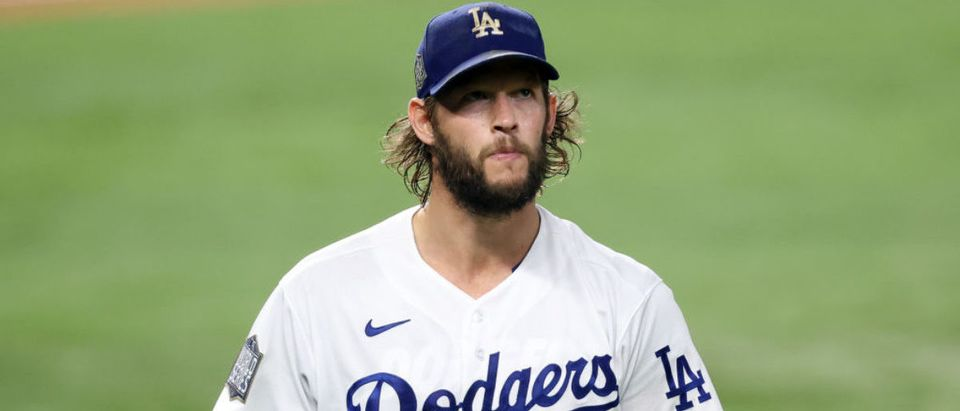 ARLINGTON, TEXAS - OCTOBER 20: Clayton Kershaw #22 of the Los Angeles Dodgers returns to the dugout after retiring the side against the Tampa Bay Rays during the fourth inning in Game One of the 2020 MLB World Series at Globe Life Field on October 20, 2020 in Arlington, Texas. (Photo by Tom Pennington/Getty Images)