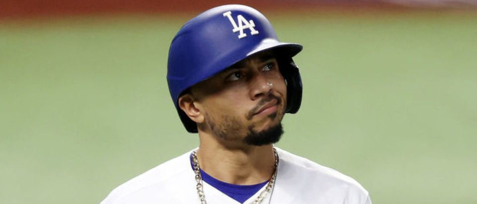 ARLINGTON, TEXAS - OCTOBER 20: Mookie Betts #50 of the Los Angeles Dodgers reacts after striking out against the Tampa Bay Rays during the third inning in Game One of the 2020 MLB World Series at Globe Life Field on October 20, 2020 in Arlington, Texas. (Photo by Tom Pennington/Getty Images)