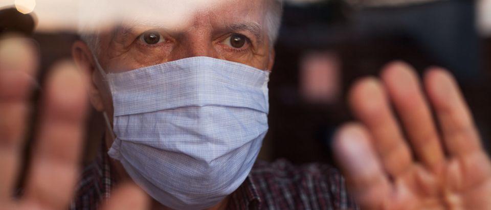 Senior in nursing home wearing mask
