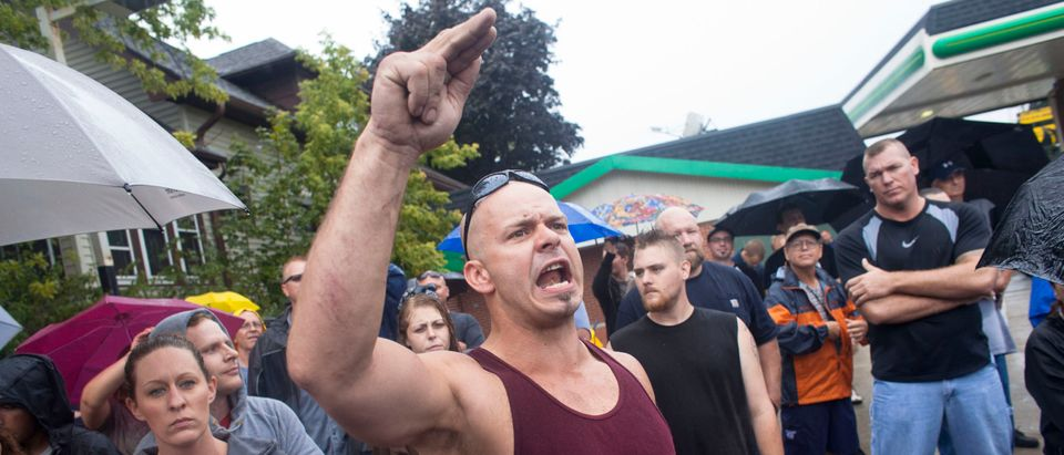 A member of a white supremacy group shouts during a gathering in West Allis