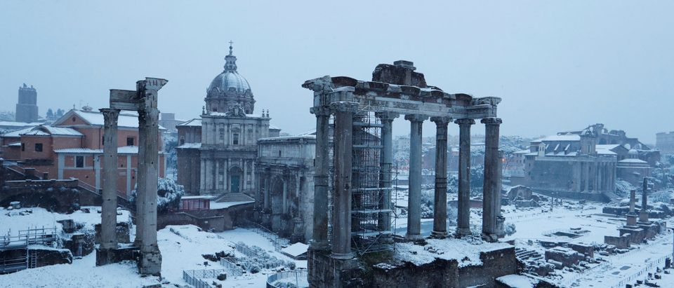 Roman Forum is seen during a heavy snowfall early in the morning in Rome