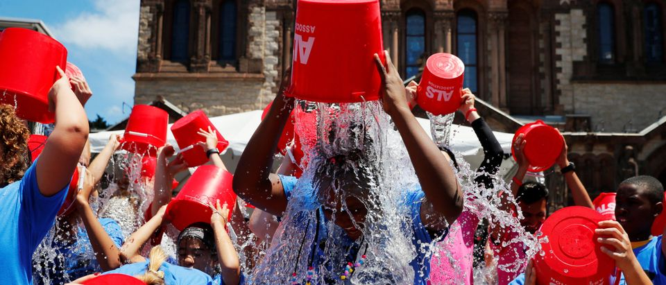 """Jahziyah Jones pours a bucket of ice water over her head to commemorate the five year anniversary of the """"ALS Ice Bucket Challenge"""" in Boston"""