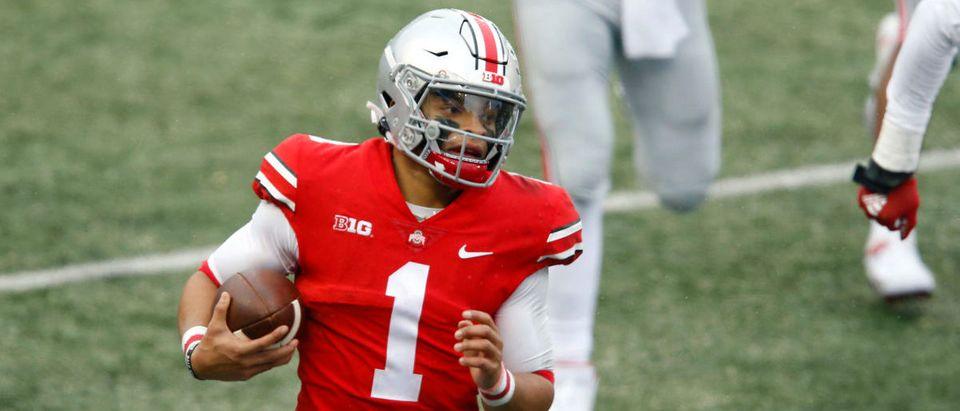 Nov 21, 2020; Columbus, Ohio, USA; Ohio State Buckeyes quarterback Justin Fields (1) runs during the second quarter against the Indiana Hoosiers at Ohio Stadium. Mandatory Credit: Joseph Maiorana-USA TODAY Sports via Reuters