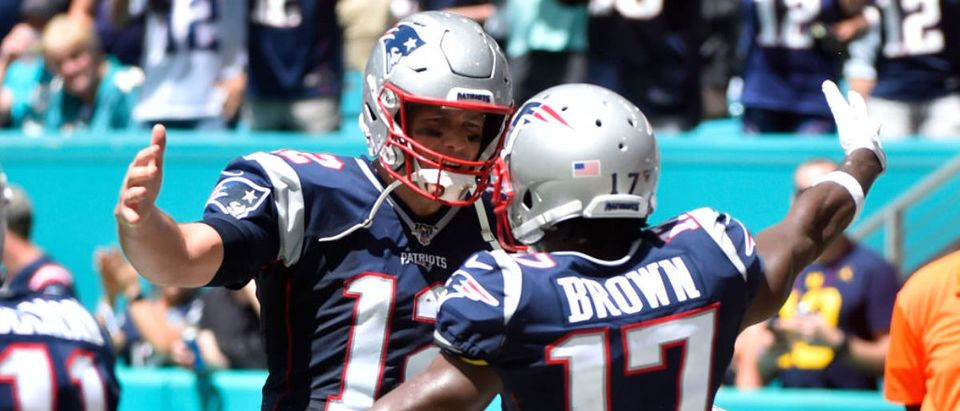 MIAMI, FL - SEPTEMBER 15: Antonio Brown #17 of the New England Patriots celebrates with Tom Brady #12 after catching a touchdown in the second quarter of the game against the Miami Dolphins at Hard Rock Stadium on September 15, 2019 in Miami, Florida. (Photo by Eric Espada/Getty Images)