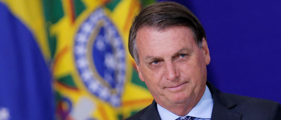 FILE PHOTO: Brazil's President Jair Bolsonaro looks on during a ceremony at the Planalto Palace