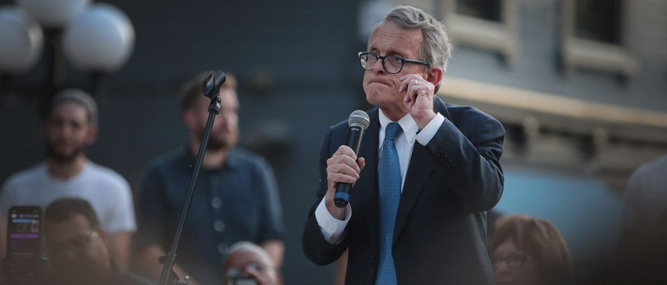 "DAYTON, OHIO - AUGUST 04: Ohio Governor Mike DeWine speaks to mourners at a memorial service in the Oregon District held to recognize the victims of an early-morning mass shooting in the popular nightspot on August 04, 2019 in Dayton, Ohio. The governor was met with shouts of ""Do something"" from the crowd. At least 9 people were reported to have been killed and another 27 injured when a gunman identified as 24-year-old Connor Betts opened fire with a AR-15 style rifle. The shooting comes less than 24 hours after a gunman in Texas opened fire at a shopping mall killing at least 20 people. (Scott Olson/Getty Images)"