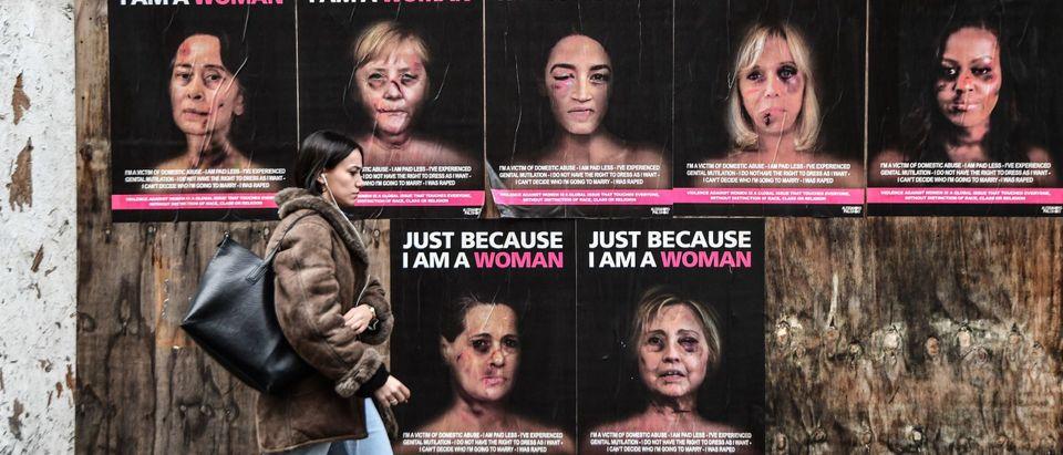 TOPSHOT-ITALY-VIOLENCE-POLITICS-WOMEN-STREET ART