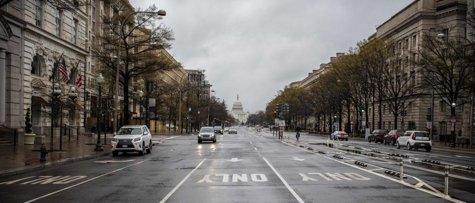 Pennsylvania avenue, one of the largest avenues of the US Capital, is almost deserted by traffic during the 6pm usual rush hour in Washington on March 25, 2020. - Local authorities have decided to shut down all non-essential businesses from March 25th to April 24th to fight the Covid-19 (Coronavirus) outbreak and avoid it's spread. (Photo by Eric Baradat/AFP via Getty Images)TOPSHOT-US-HEALTH-VIRUS
