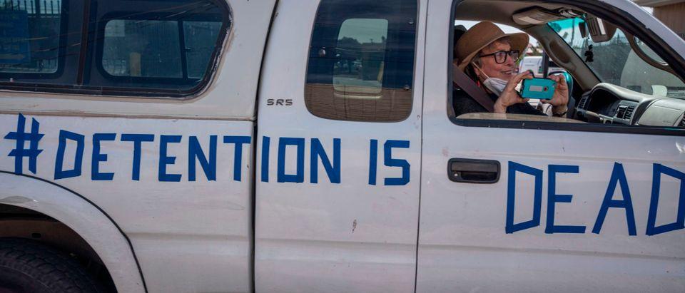US-HEALTH-VIRUS-IMMIGRATION-PROTEST