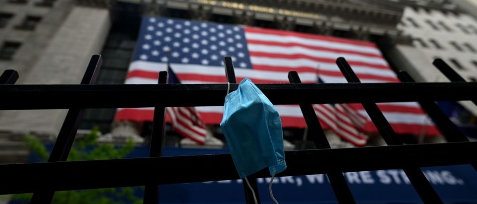 A face mask is seen in front of the New York Stock Exchange (NYSE) on May 26, 2020 at Wall Street in New York City. - Global stock markets climbed Monday, buoyed by the prospect of further easing of coronavirus lockdowns despite sharp increases in case rates in some countries such as Brazil. Over the weekend, US President Donald Trump imposed travel limits on Brazil, now the second worst affected country after the United States, reminding markets that while the coronavirus outlook is better, the crisis is far from over. (Photo by Johannes Eisele/AFP via Getty Images)
