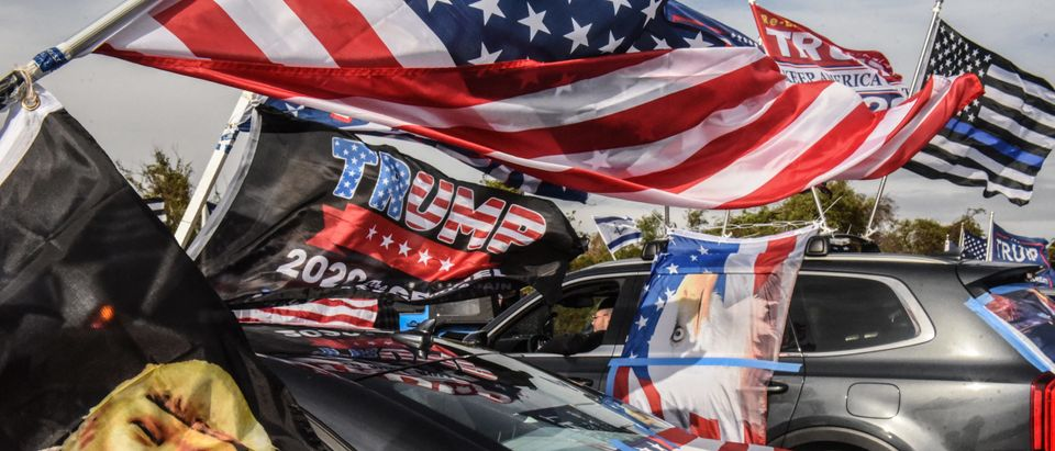 """NEW YORK, NY - NOVEMBER 01: Trump supporters gather with their flags at Floyd Bennet Field on November 1, 2020 in the Queens borough in New York City. With just two day left before the U.S. Presidential election, Trump supporters coordinated large caravans across the country dubbed """"Maga drag."""" (Stephanie Keith/Getty Images)"""