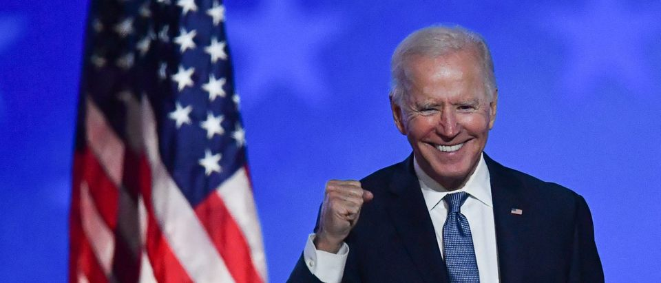 """Democratic presidential nominee Joe Biden gestures after speaking during election night at the Chase Center in Wilmington, Delaware, early on November 4, 2020. - Democrat Joe Biden said early Wednesday he believes he is """"on track"""" to defeating US President Donald Trump, and called for Americans to have patience with vote-counting as several swing states remain up in the air. """"We believe we are on track to win this election,"""" Biden told supporters in nationally broadcast remarks delivered in his home city of Wilmington, Delaware, adding: """"It ain't over until every vote is counted."""" (Photo by Angela Weiss/AFP via Getty Images)"""