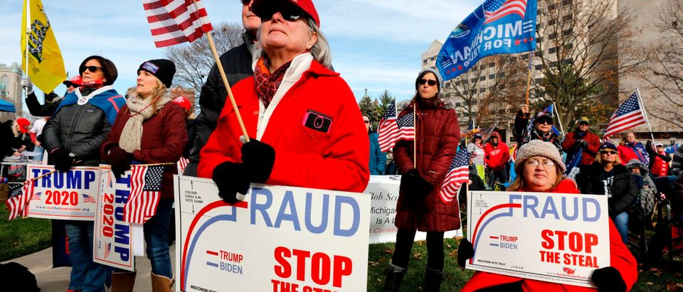 "People gather at the Michigan State Capitol for a ""Stop the Steal"" rally in support of US President Donald Trump on November 14, 2020, in Lansing, Michigan. - Supporters are backing Trump's claim that the November 3 election was fraudulent. (JEFF KOWALSKY/AFP via Getty Images)"