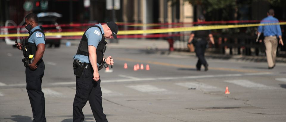 CHICAGO, ILLINOIS - AUGUST 10: Police investigate where a shooting took place on Michigan Ave. hours after the city suffered from widespread looting and vandalism, on August 10, 2020 in Chicago, Illinois. Police made several arrests during the night of unrest and recovered at least one firearm. (Scott Olson/Getty Images)