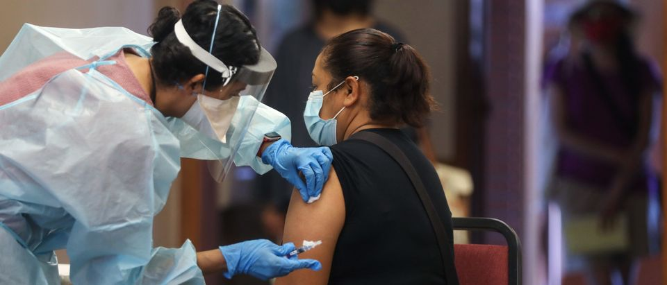 Southern California Residents Line Up For Flu Shots At Local Library