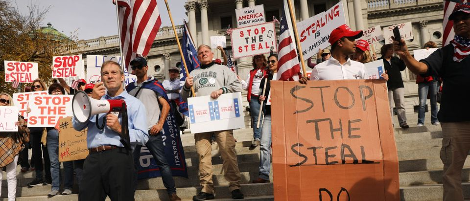 Representative Jim Jordan stands with dozens of people calling for stopping the vote count in Pennsylvania due to alleged fraud against President Donald Trump gather on the steps of the State Capital on November 05, 2020 in Harrisburg, Pennsylvania. (Spencer Platt/Getty Images)