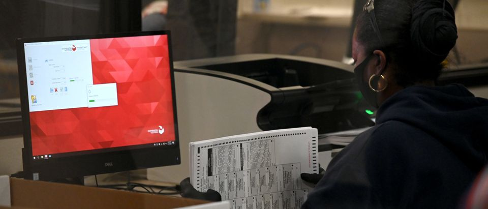 NORTH LAS VEGAS, NEVADA - NOVEMBER 07: A Clark County election worker scans mail-in ballots at the Clark County Election Department on November 7, 2020 in North Las Vegas, Nevada. Supporters around the country are taking to the streets to celebrate after news outlets have declared Democratic presidential nominee Joe Biden winner over President Donald Trump in the U.S. Presidential race. (Ethan Miller/Getty Images)