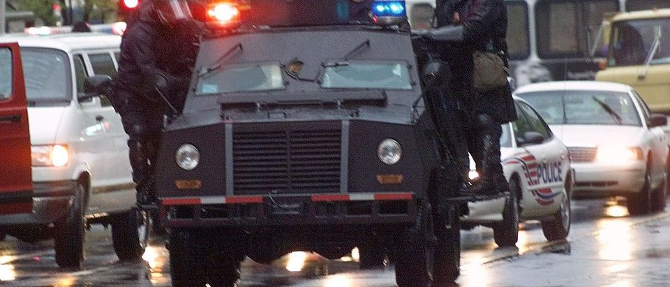 Police patrol the streets on an armored car 17 Apr