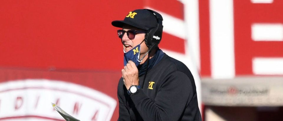 Nov 7, 2020; Bloomington, Indiana, USA; Michigan Wolverines head coach Jim Harbaugh talks to a referee during the second half of the game at Memorial Stadium. The Indiana Hoosiers defeated the Michigan Wolverines 38 to 21. Mandatory Credit: Marc Lebryk-USA TODAY Sports via Reuters