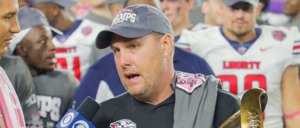 ORLANDO, FLORIDA - DECEMBER 21: Head coach Hugh Freeze of the Liberty Flames is interviewed after defeating the Georgia Southern Eagles in the 2019 Cure Bowl at Exploria Stadium on December 21, 2019 in Orlando, Florida. (Photo by James Gilbert/Getty Images)