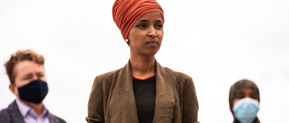 ST PAUL, MN - AUGUST 05: Rep. Ilhan Omar (D-MN) (C) listens as she receives an endorsement from Valerie Castile, mother of Philando Castile, during a press conference outside the DFL Headquarters on August 5, 2020 in St Paul, Minnesota. Omar is hoping to retain her seat as the representative for Minnesota's 5th Congressional District in next week's primary election. (Photo by Stephen Maturen/Getty Images)