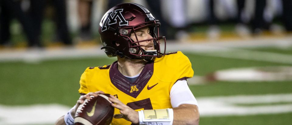 Nov 20, 2020; Minneapolis, Minnesota, USA; Minnesota Golden Gophers quarterback Tanner Morgan (2) drops back for a pass in the first half against the Purdue Boilermakers at TCF Bank Stadium. Mandatory Credit: Jesse Johnson-USA TODAY Sports via Reuters