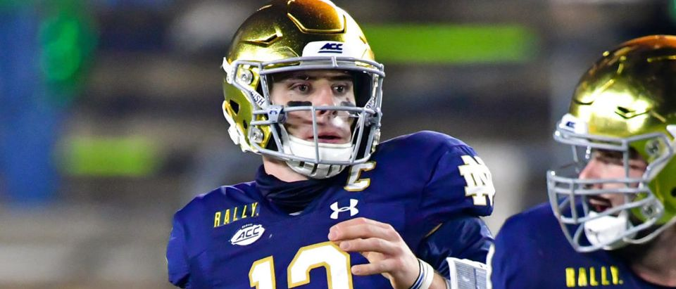 Nov 7, 2020; South Bend, Indiana, USA; Notre Dame Fighting Irish quarterback Ian Book (12) looks to throw in the second quarter against the Clemson Tigers at Notre Dame Stadium. Notre Dame defeated Clemson 47-40 in two overtimes. Mandatory Credit: Matt Cashore-USA TODAY Sports via Reuters