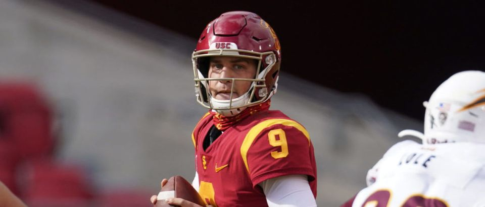 Nov 7, 2020; Los Angeles CA, USA; Southern California Trojans quarterback Kedon Slovis (9) throws the ball in the second quarter against the Arizona State Sun Devils at the Los Angeles Memorial Coliseum. Mandatory Credit: Kirby Lee-USA TODAY Sports via Reuters