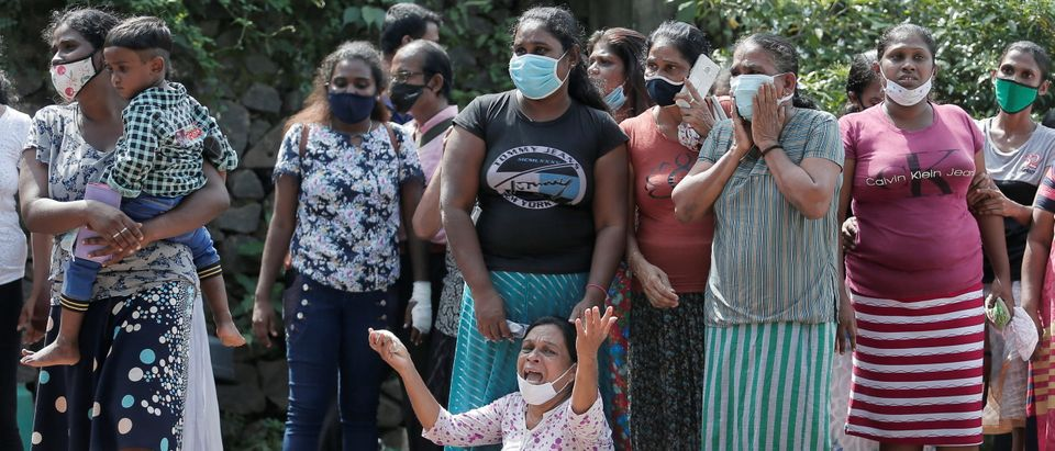 Family members of inmates react outside the prison, following unrest at Mahara Prison, in Colombo