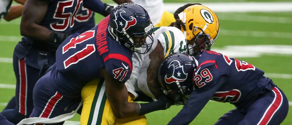 Oct 25, 2020; Houston, Texas, USA; Houston Texans inside linebacker Zach Cunningham (41) and cornerback Phillip Gaines (29) make a tackle on Green Bay Packers running back Jamaal Williams (30) during the third quarter at NRG Stadium. Mandatory Credit: Troy Taormina-USA TODAY Sports via Reuters