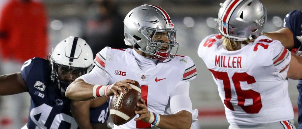 Oct 31, 2020; University Park, Pennsylvania, USA; Ohio State Buckeyes quarterback Justin Fields (1) looks to throw a pass during the third quarter against the Penn State Nittany Lions at Beaver Stadium. Mandatory Credit: Matthew OHaren-USA TODAY Sports via Reuters