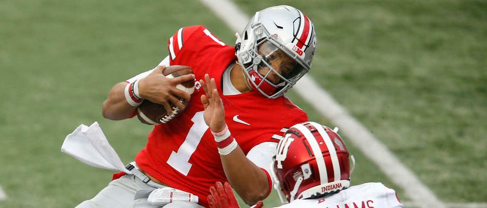 Nov 21, 2020; Columbus, Ohio, USA; Ohio State Buckeyes quarterback Justin Fields (1) runs while defended by Indiana Hoosiers defensive back Jaylin Williams (23) during the second quarter at Ohio Stadium. Mandatory Credit: Joseph Maiorana-USA TODAY Sports via Reuters