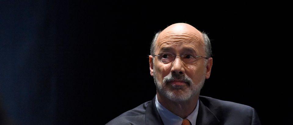 Tom Wolf awaits the start of the final debate among the democratic gubernatorial candidates in Philadelphia