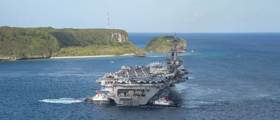 The U.S. Navy aircraft carrier USS Theodore Roosevelt departs following an extended visit in the midst of a coronavirus disease outbreak in Guam