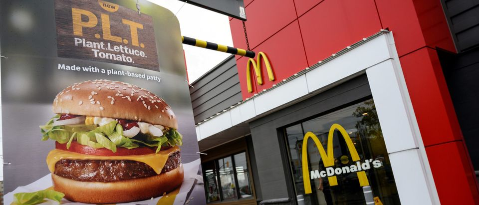"""A sign promoting McDonald's """"PLT"""" burger with a Beyond Meat plant-based patty at one of 28 test restaurant locations in London, Ontario"""