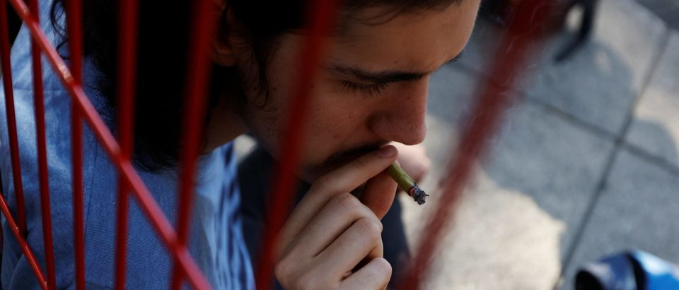 A man smokes a marijuana joint outside Mexico's Senate building at the protest cannabis garden of the Cannabico Mexican Movement in Mexico City