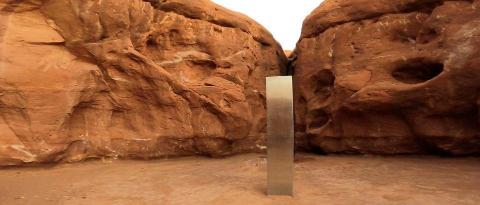 A metal monolith is seen in Red Rock Desert, Utah