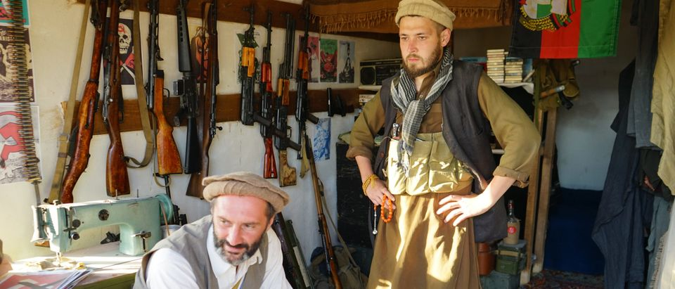 Afghan militants of the Taliban terrorist organization with an Arsenal of weapons from the 1970s-80s, historical festival September 14, 2019, Sevastopol by Dmitriyk21. Shutterstock.