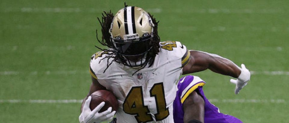 NEW ORLEANS, LOUISIANA - DECEMBER 25: Alvin Kamara #41 of the New Orleans Saints makes a reception past Jeff Gladney #20 of the Minnesota Vikings during the fourth quarter at Mercedes-Benz Superdome on December 25, 2020 in New Orleans, Louisiana. (Photo by Chris Graythen/Getty Images)