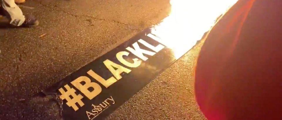 BLM banner burns in DC (Screenshot @shelbytalcott on Twitter)