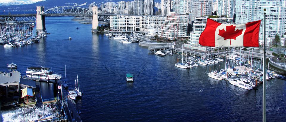 Canadian Flag in Vancouver by Hannamariah. Shutterstock.